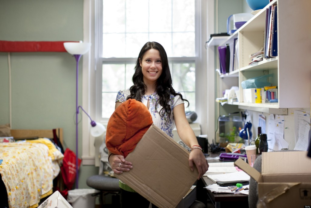 Mixed race woman moving into college dorm room