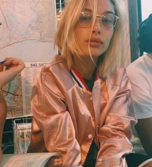 She looks so cool wearing these vintage frames!