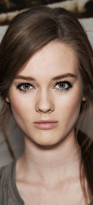 dark eye makeup on beautiful pale skin