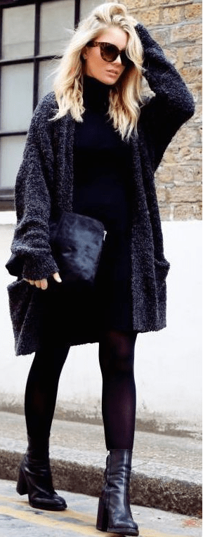 This black fuzzy sweater worn over a black turtleneck dress will compliment any fall wardrobe!