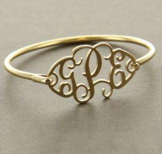 This gold mongram bracelet is so cute!
