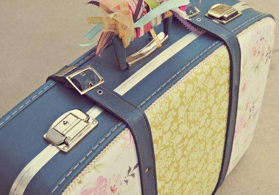 Adding ribbon to the handles are cute ways to personalize your luggage!