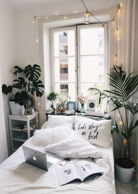 Graphic pillows look super cute in boho dorm rooms!