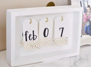 A trendy calendar is a great DIY dorm room decor idea!