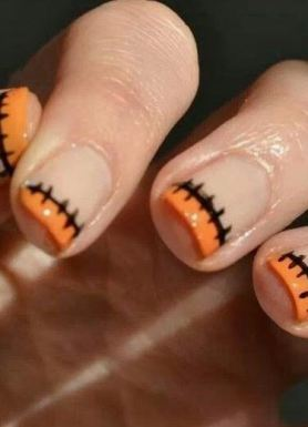 This French manicure is a cute Halloween nail art design.