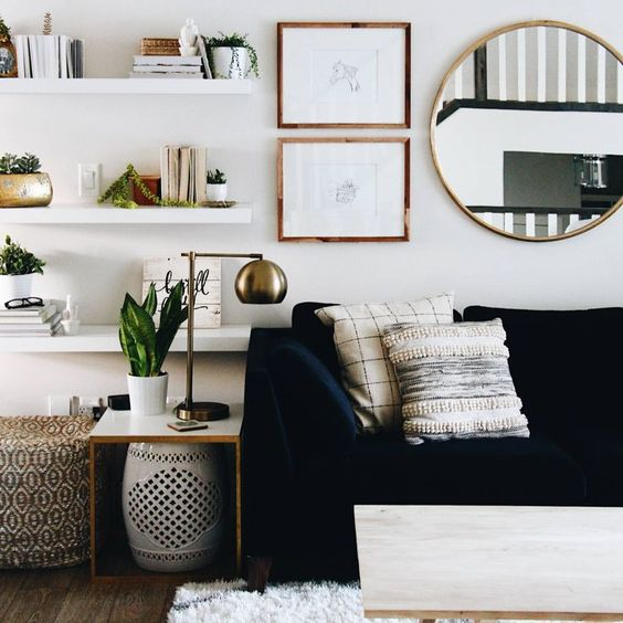 Try one of the best cute living room ideas with brassy accessories and open shelving.