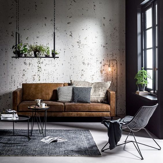 Try one of the best cute living room ideas with grey tones and caramel leather.