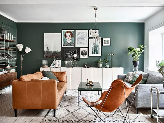 Try one of the best cute living room ideas with a statement wall and glass lighting.