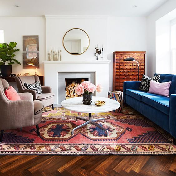 Try one of the best cute living room ideas with multi-colored rugs and furnishings.
