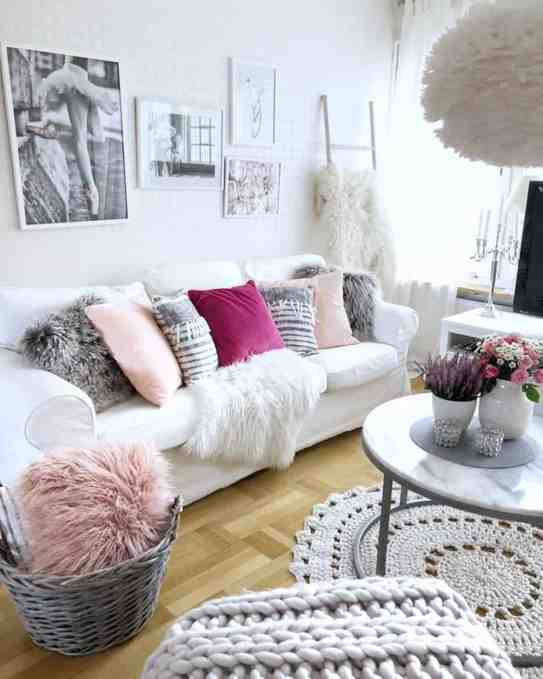 white and pink cozy living room decor