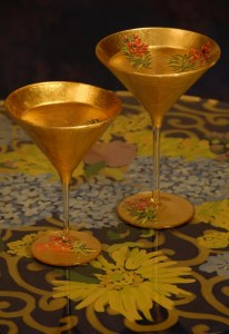 Jan Maitland-Two Gilded Martini Glasses on table top