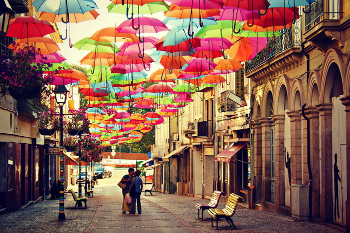 The colorful umbrella street of famous Ágitagueda art festival in Portugal