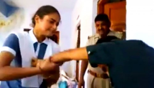 This Girl Brutally Beats Up a Boy Inside UP Police Station for Harassing Her