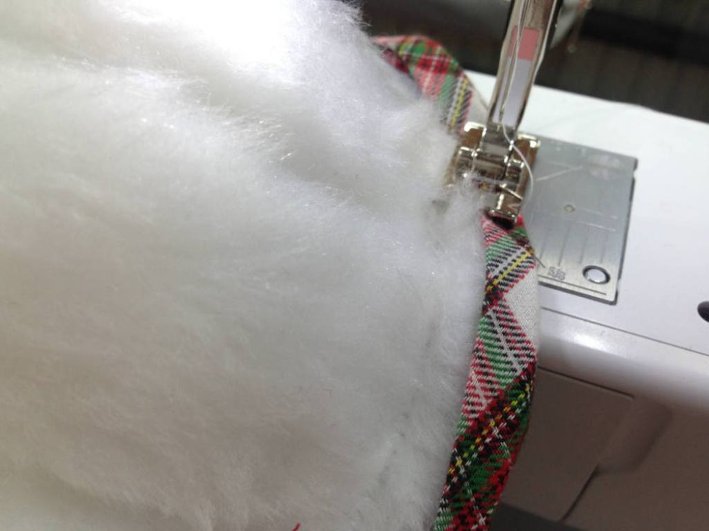 Sew the slanting tape to the artificial fur  how to sew a christmas stocking easy