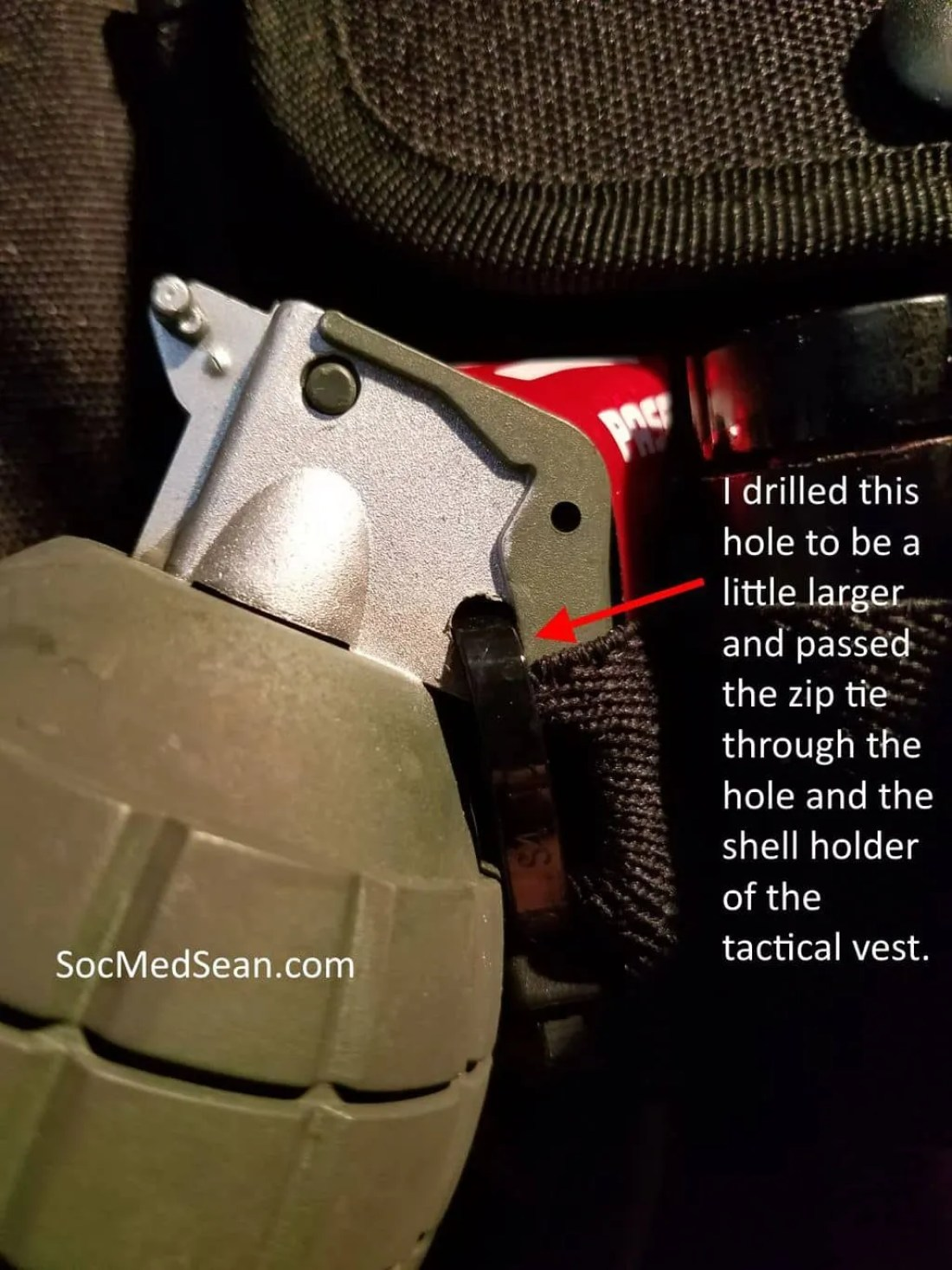 The grenades are secured to the tactical vest with a zip tie