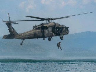 A Salvadoran Special Forces Soldier helocasts from a UH-60 Blackhawk in Dec 2016 during Operation Serpiente (photo by MSG Kerri Spero, JTF Bravo).