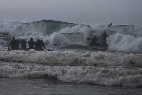 """Green Berets from 1st Special Forces Group conduct small boat training in the ocean surf. (photo from USSOCOM """"Tip of the Spear"""", January 2017). Tip of the Spear January 2017"""