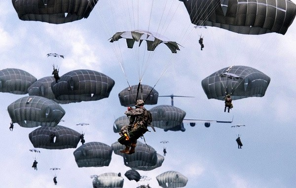 Paratroopers descending under canopy. (Photo source Fort Bragg, North Carolina, June 6, 2017)