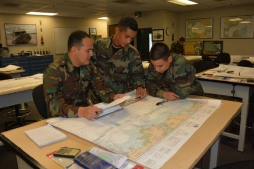NAVSCIATTS Students in the Patrol Craft Officer - Coastal course conduct classroom navigation exercises. (Photo by Angela Fry, NAVSCIATTS, June 13, 2017).