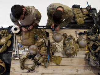 Special Forces Green Berets prepare their weapons and gear prior to a training event. (photo by Tech Sgt Jorge Intriago, South Carolina National Guard, May 19, 2014).