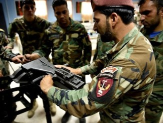 weapons maintenance and repair facility - ANASOC instructor demonstrates how to do a function check on a MK 19, 40 mm grenade launcher at Camp Commando, Kabul, Afghanistan. (NSOCC-A photo by MSG Felix Figueroa).