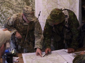 Saber Junction 18 - KASP and 20th SFGA personnel conduct mission planning. Photo by 1st Lt Benjamin Haulenbeek; SOCEUR, Sep 19, 2018.
