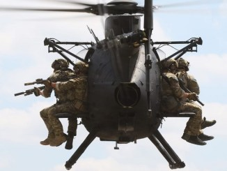 Rangers fly on Little Bird helicopter. USASOC photo (2018).