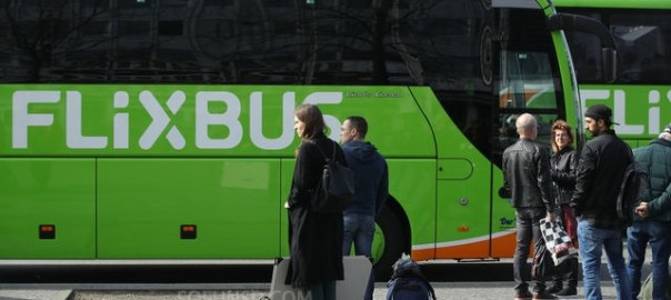 BERLIN, GERMANY - APRIL 04:  Passengers wait to board a Flixbus intercity bus at Alexanderplatz on April 4, 2018 in Berlin, Germany. Flixbus launched its intercity bus transport service in 2013 and now dominates the European market. Flixbus owns neither a single bus nor employs a single bus driver, but rather works with approximately 300 partner companies all under the Flixbus logo. The company plans to enter the United States market with intercity service on the West Coast this summer.  (Photo by Sean Gallup/Getty Images)