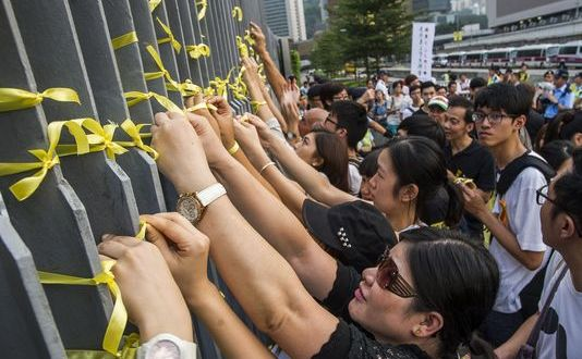 Hong Kong students skip classes to demand democratic elections