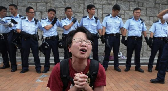 Hong Kong chief vows to remain as tensions deepen with pro-democracy protesters