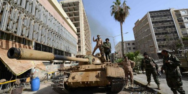 Wider Chaos Threatens as Fighters Seize Branch of Libya's Central Bank