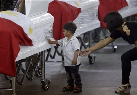 Philippines mourns 44 commandos; terror suspect hunted