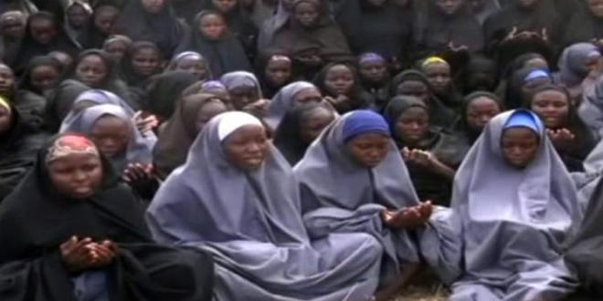 Year after schoolgirls taken, report catalogs Boko Haram atrocities