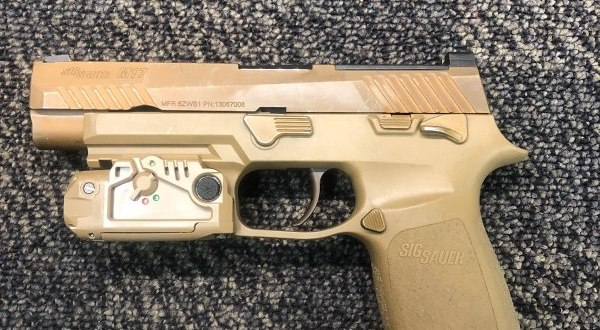 Here's a sneak peek at a laser/light combo for the Army's newest pistol | Army Times