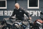 Bald man with a motorcycle