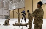 Soldiers setting up cameras