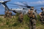 Marines with a helicopter