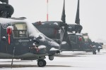 Air Commandos from the 352d Special Operations Maintenance Squadron clear snow and ice off a CV-22 Osprey