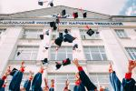 Picture of college graduates throwing their caps in the air. Picture for decorative purposes only.