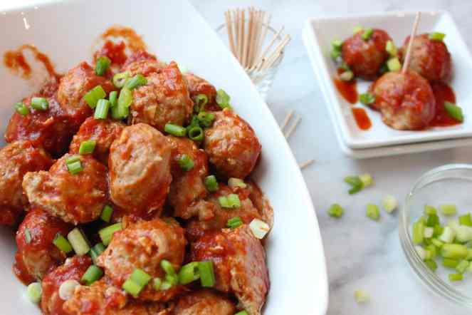 These Surly Hell BBQ Chicken Meatballs are the perfect party appetizer! Chicken makes them lean and healthy, while the homemade BBQ sauce leaves them spicy, lip smacking, and absolutely addictive. They're baked, but can be kept warm in your slow cooker or crockpot! Make a HUGE batch, of these - they go fast! | #SoHappyYouLikedIt