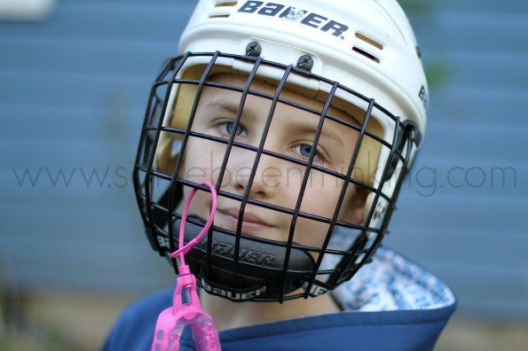 Figuring Out My Why, So I've Been Thinking, blue eyed boy in Bauer hockey helmet with pink mouthguard