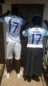 Olunga  with the mum with both jerseys christened Olunga