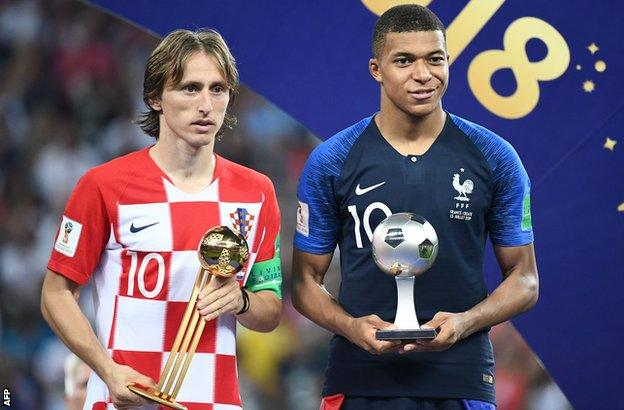 Luka Modric (left) poses with the Golden Ball with Kylian Mbappe holding his Young Player Award