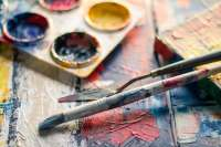 selective focus photography of paintbrush near paint pallet