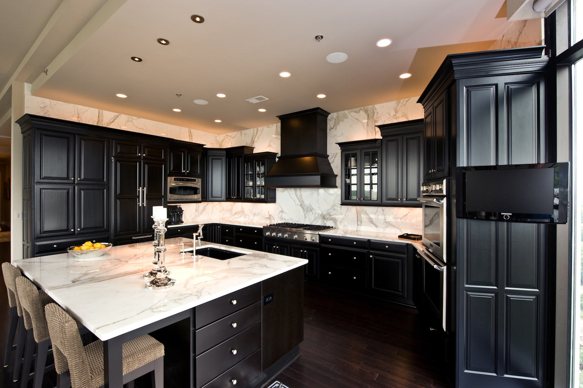 Bella View: Calacatta Gold Marble Countertop on Backsplash For Black Granite Countertops And White Cabinets  id=58642