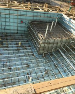 Installation of hydronic heating in a pool
