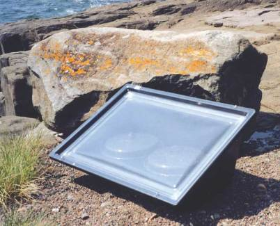 Sport Solar Oven on rocky shore.