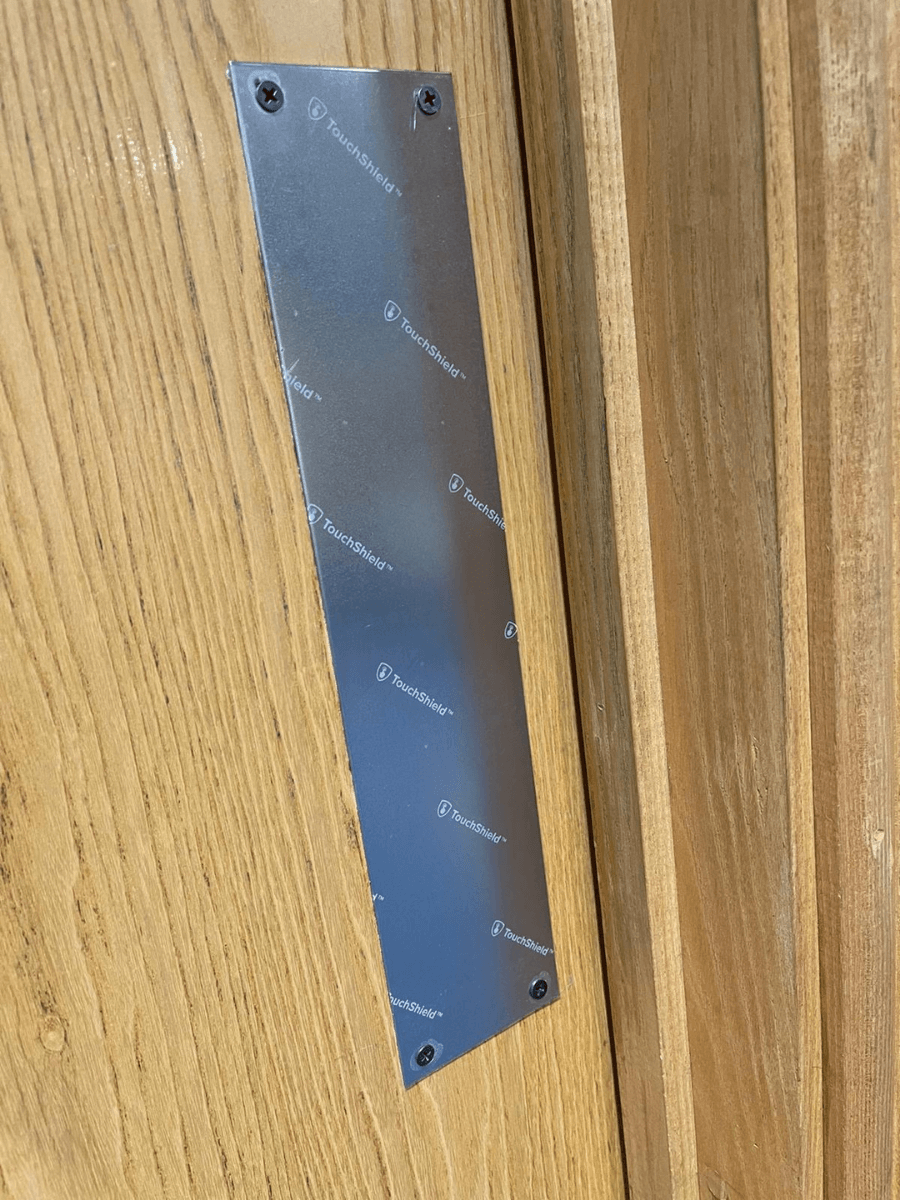 Anti-Microbial Film on a door push