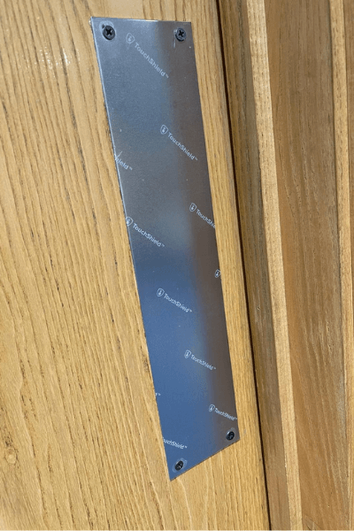 Anti-microbial film applied to door push panels