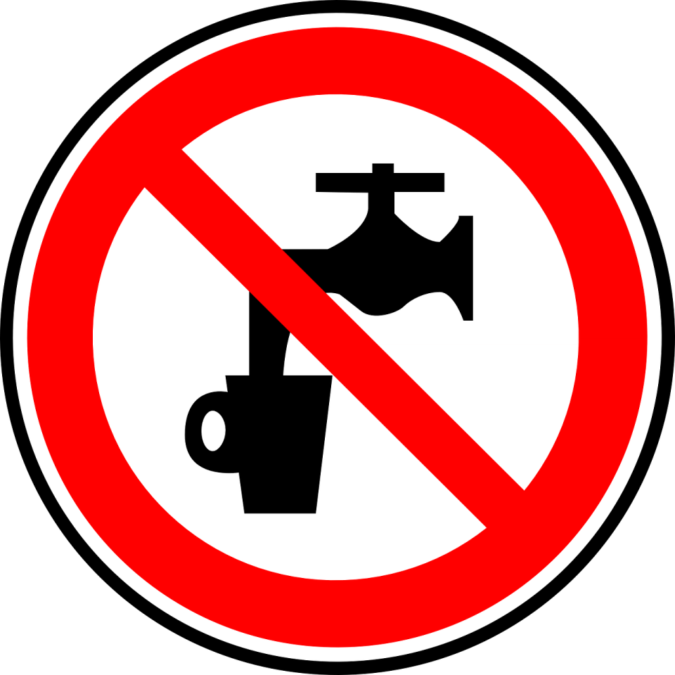 """Image of a warrning notice saying """"water not safe for drinking!"""""""